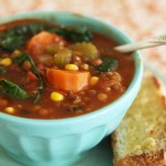 Lentil, vegetable, rice and tomato soup with kale