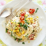 Spaghetti with sweetcorn, cherry tomatoes and herbs