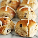 Dried cranberry, white chocolate and orange hot cross buns