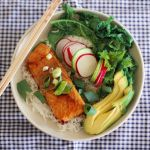 Teriyaki salmon rice bowl with kale and avocado