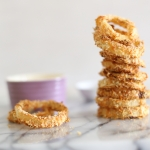Oven baked crispy spicy onion rings with lime chilli yoghurt dip