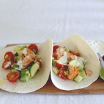 Spicy salmon soft tacos with avocado, cherry tomato & corn salsa
